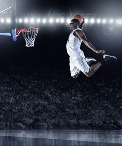 Basketball Player Dunking a Basketball During a Game