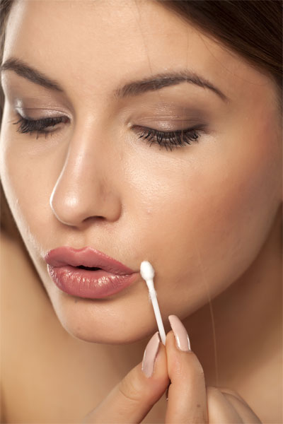 Use Q-tips or cotton swabs for makeup application of removal