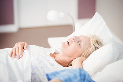 Woman snoring with sleep apnea