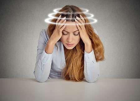 Woman suffering from vertigo dizziness nausea