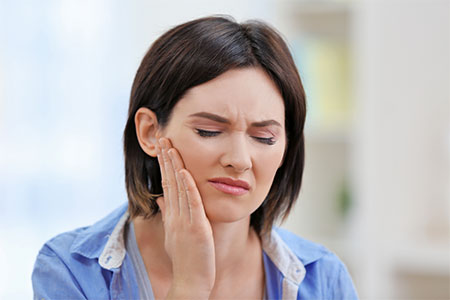 Woman with TMJ and pain in her jaw